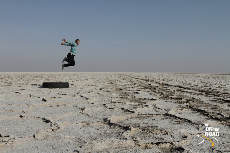 Leaping high on the salt desert of Maranjab, Iran