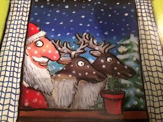 Santa and reindeer peeking through the window