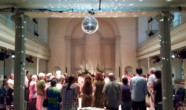 picture of disco ball above parishioners at St. Mark's in the Bowery (NYC). Photo from their FB page?