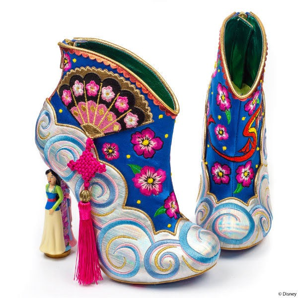 pair of ankle boots with Eastern inspired uppers and fan and tassel detail on side
