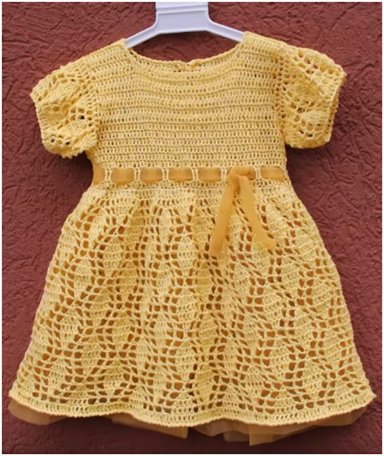 Yellow crochet dress with delicate leaves pattern