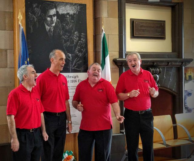 The Sandbars a cappella quartet greet the Sligo Food Train at the station in Sligo Town.