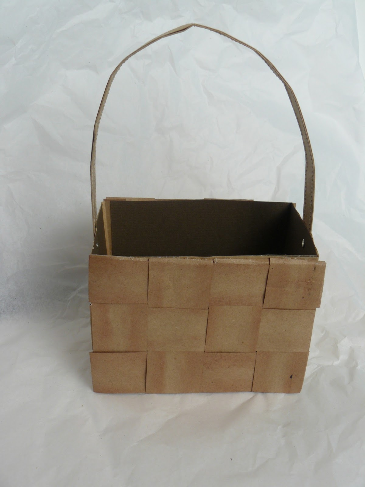 On bag #2, stop folding at 2 inch from the bottom. Now place the tallest bag inside of the medium bag. Put handle around these 2 bags, tape handle to the sides of the two bags, glue or tape last bag to the bottom. Now you have a quick and easy basket.