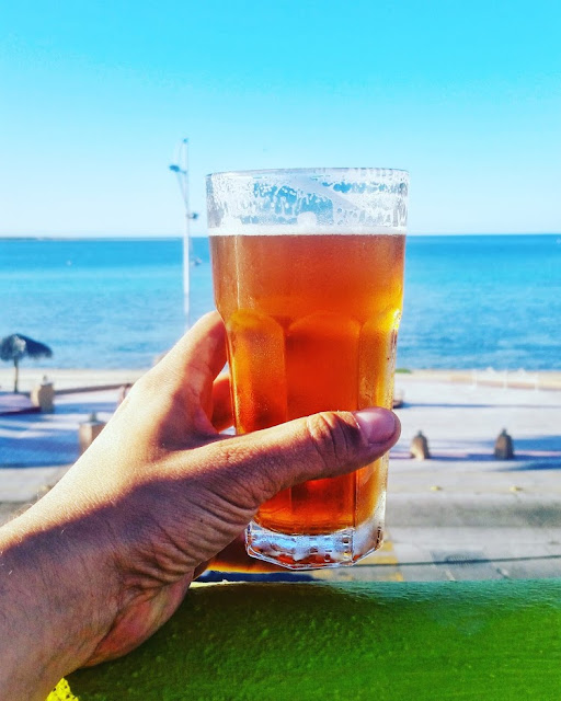 a beer at La Paz beach in Baja California, Mexico