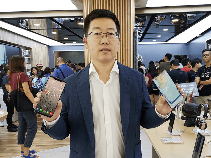 George Li, the country manager of Huawei in the Philippines with the Mate 20 Pro and Mate 20