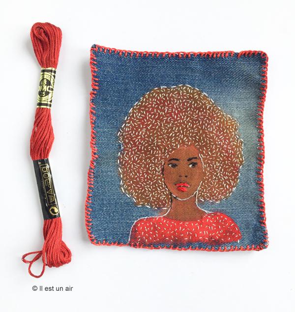 Broderie de femme sur toile de jean - portrait afro