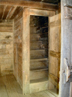 Stairs to the second floor/attic sleeping area. Note how steep the stairs are.