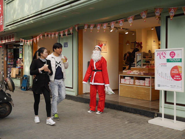 young Chinese woman dressed up as Santa