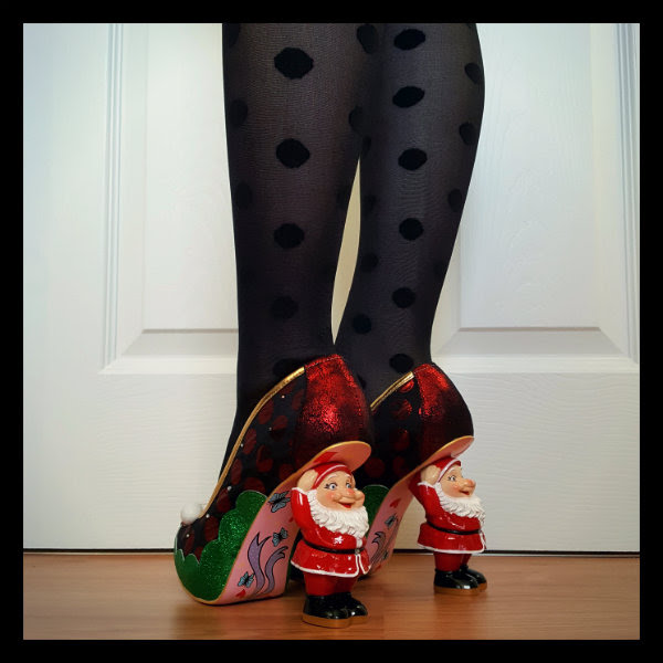 Father Christmas red character heel Christmas shoes on feet