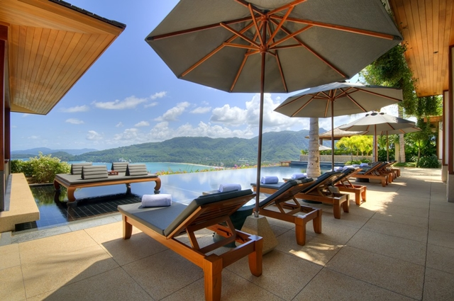 Pool and furniture by the pool with an amazing view