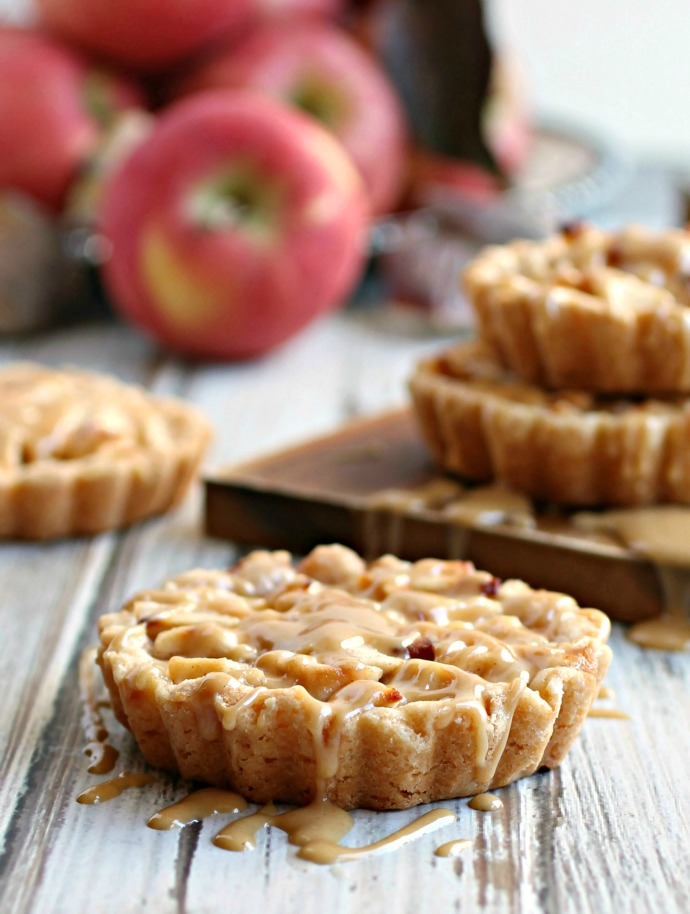 Recipe for individual apple tarts with a peanut crust and peanut butter glaze.