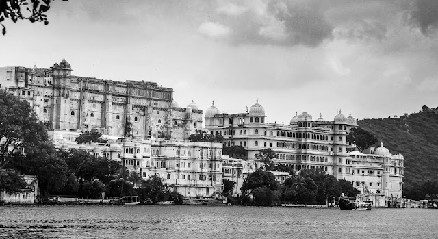 "Udaipur : Udaipur is also known as the ""City of Lakes"" in beautiful state of Rajasthan. It is surrounded by Aravali Range, which separates it from Thar Desert.    Udaipur is approx 650+ km from Delhi and approximately 800 km from Mumbai, placed almost in the middle of two major Indian metro cities.    Besides, connectivity with Gujarat ports provide Udaipur a strategic geographical advantage. Udaipur is well connected with nearby cities and states by means of road, rail and air transportation facilities, including Maharana Pratap Airport.    How to reach : Delhi to Udaipur distance if ~650 kms."