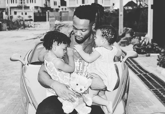 Flavour carries his two lovely daughters