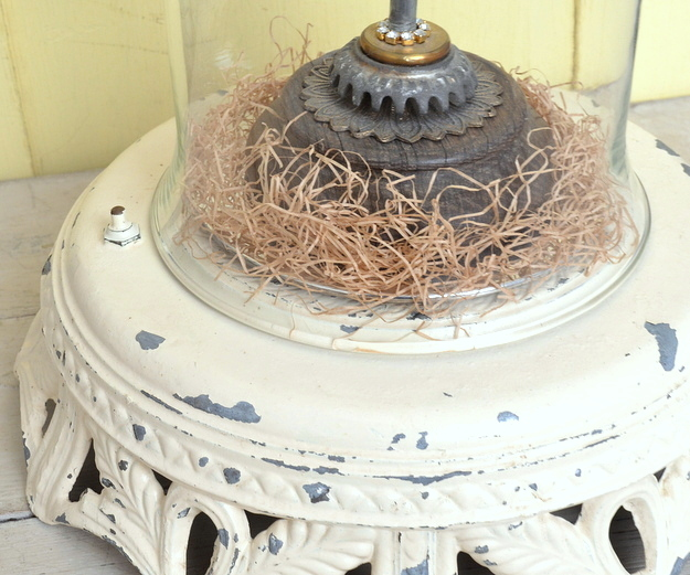 Turn a heavy vintage floor lamp base into a base for a cloche.