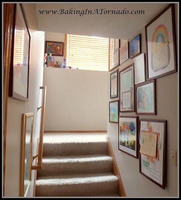 Family stairway art gallery | www.BakingInATornado.com