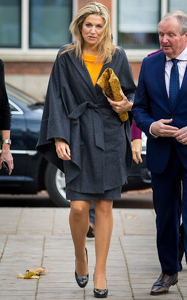 Queen Maxima wore Natan wool skirt and Natan yellow color top, Gold earrings, Cartier watch, Christian Louboutin Women Shoes, style royal