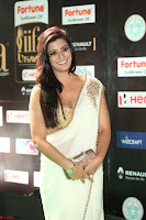 Varalakshmi in Cream Saree Sleeveless Backless Deep Neck Choli at IIFA Utsavam Awards March 2017 059.JPG
