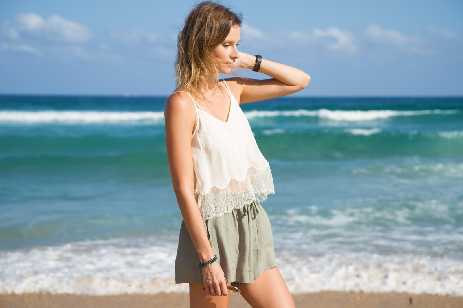 fashion and travel blogger, Alison Hutchinson, is wearing an aritzia cropped tank and Topshop shorts