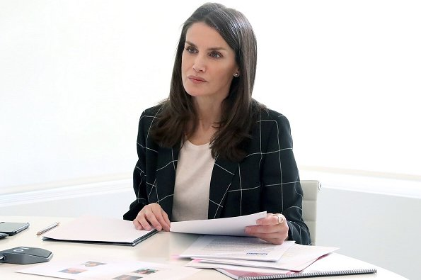 Queen Letizia wore a windowpane double-breasted jacket by Emporio Armani. Letizia wore Hugo Boss navy windowpane blazer