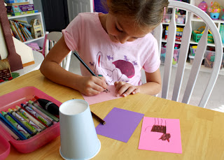 The girls in our Journey group are decorating paper cups with art that represents their favorite animals. Tessa chose to decorate her cup with drawings of cats.