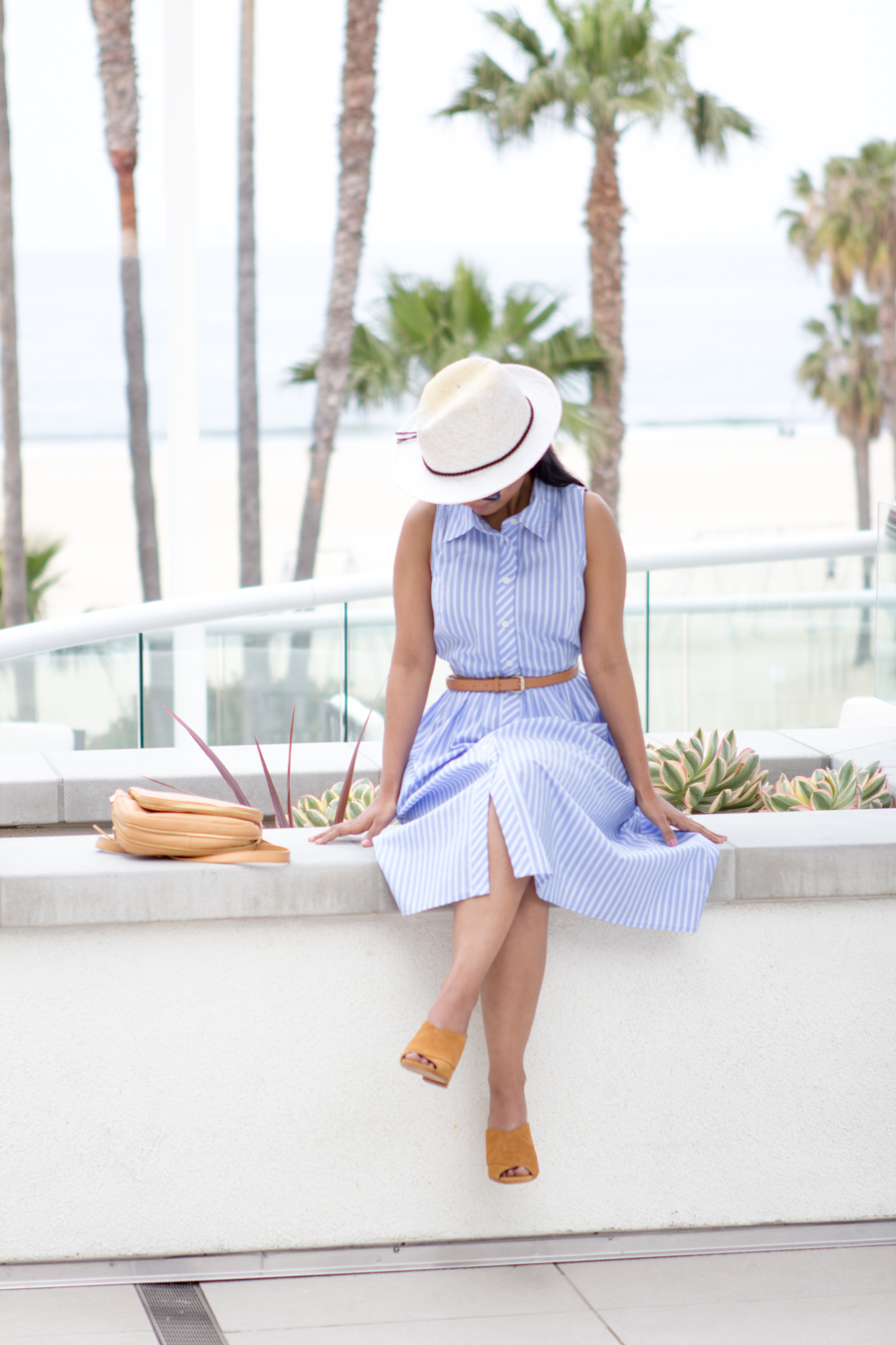 vacation wear, holiday dressing, poolside with cocktails, relaxed dressing, chic dress, belted dress, shirtdress, panama hat, express runway, pearl earrings, stella mccartney, square sunglasses, relaxing by the pool, mules, mustard slides, vince camuto, spring lookbook