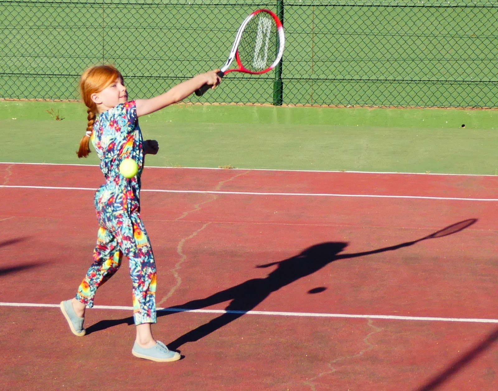 How to access free tennis sessions for kids across the North East this summer with LTA and #TennisForKids - girl on tennis court