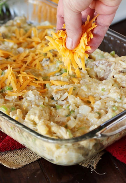 Sprinkling Chicken Rice Casserole with Shredded Cheese Image