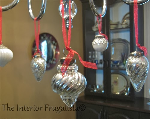 Mercury ornaments hung from a chandelier