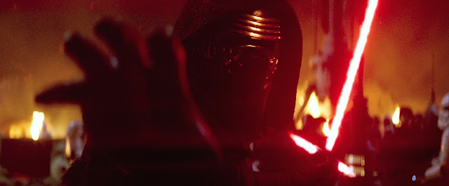 kylo ren using force to stop laser blast