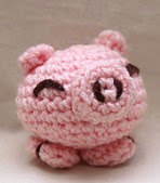 http://www.ravelry.com/patterns/library/pig-heads-or-tails