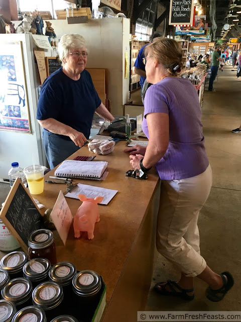 buying Ohio pork sausage from Jean Mattis of KJB Farms at the 2nd Street Farmer's Market in Dayton