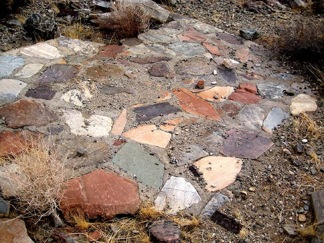 The colorful stones in this cabin foundation reflect the rich array of minerals found at the Silver Bell Mine.