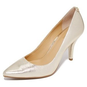 Mid flex pumps in gold, $99 from Michael Kors