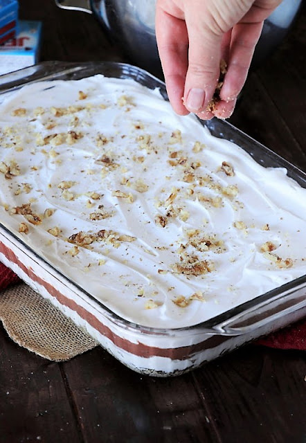 Topping Chocolate Lush Dessert with Chopped Pecans Image