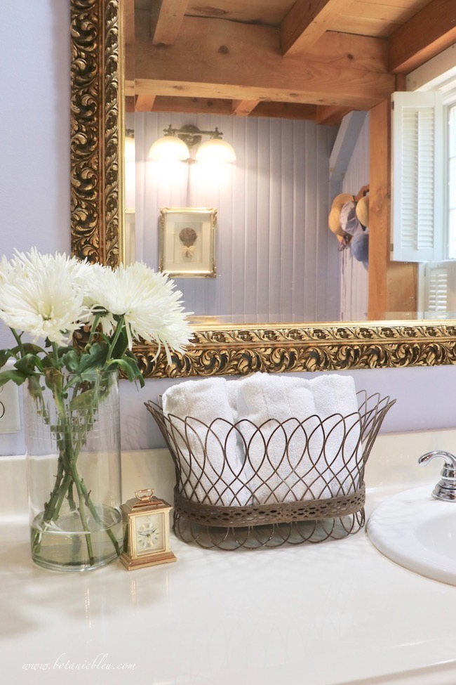 french wire basket with towels in master bathroom adds french country style
