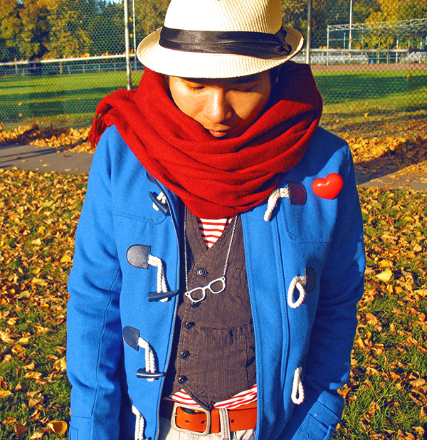 Montrealer guy in electric blue turquoise duffle coat by H&M, giant wool red scarf with white Straw Fedora hat