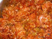 Lasaña de carne a la boloñesa-añadiéndole la salsa