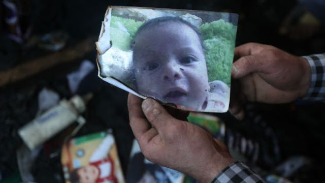 18-month-old baby and his parents in the near Nablus Dumah was sleeping in his home in the village when it was torched