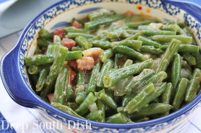 Green beans with onions and tasso or andouille, smothered in a light roux gravy.
