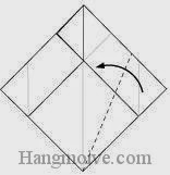 Bước 7: Gấp chéo cạnh giấy sang trái.
