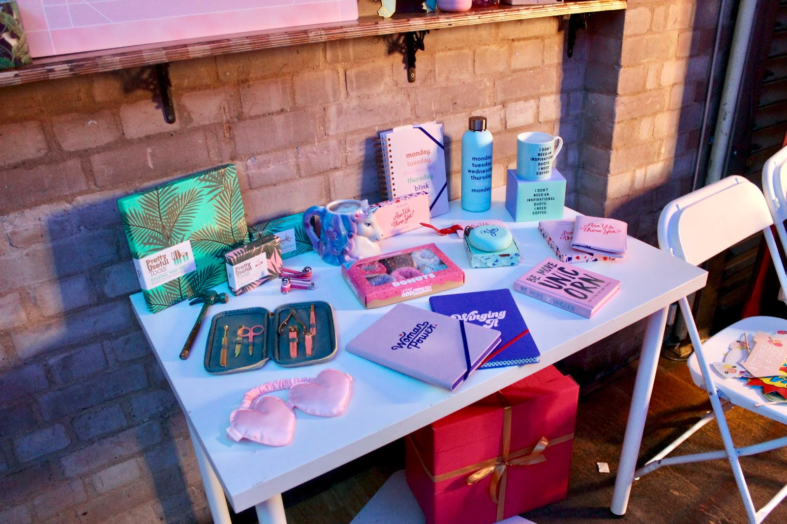 A selection of Prezzybox items on a table at the Jingle Mingle event