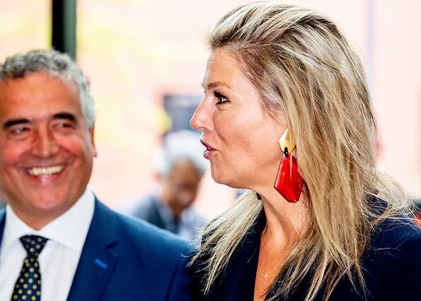 Queen Maxima wore Natan crepe jumpsuit. Queen Maxima's outfit is by Belgian fashion house Natan. red sandals and clutch