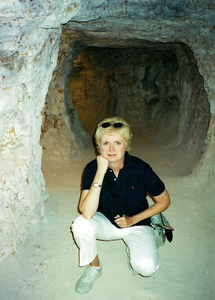 woman crouching in a mining tunnel