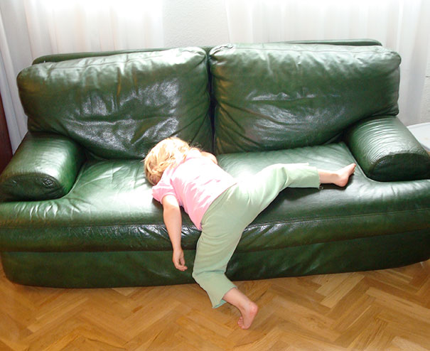 15+ Hilarious Pics That Prove Kids Can Sleep Anywhere - Napping On A Halfway To Sofa