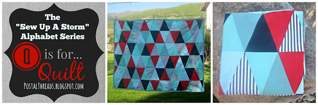 triangle quilt with nautical colors--navy, red, ombre aquas/blues, grey & white stripes