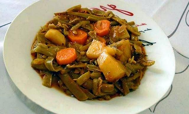 Fasolakia ladera with potatoes and carrots in tomato juice