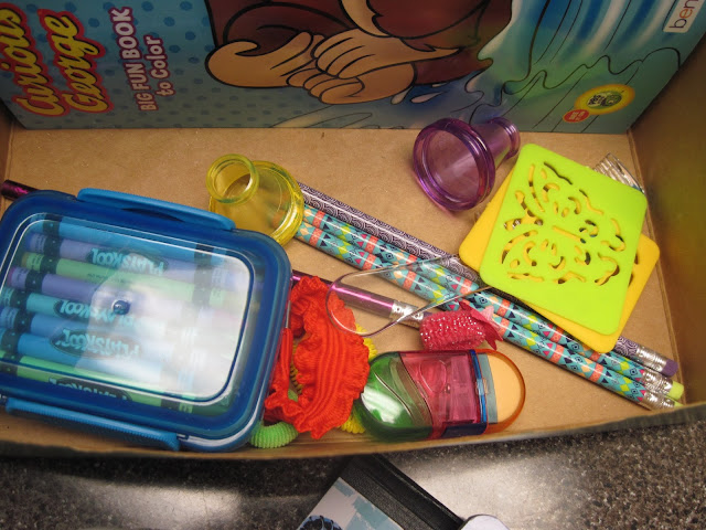 How to pack an OCC shoebox -- the bottom layer.