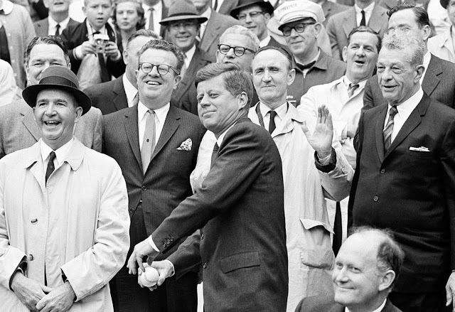 President Kennedy starts a windup for the pitch to open the American League baseball season, on April 8, 1962, in Washington.