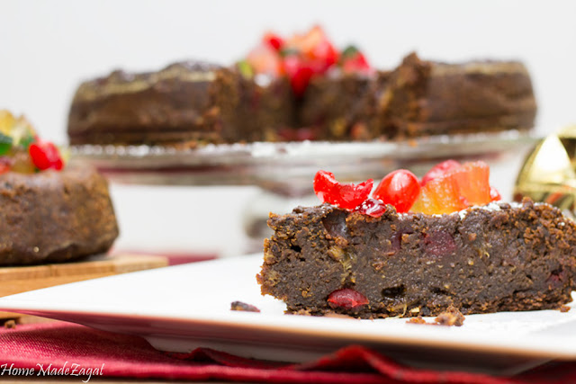 A decadent Caribbean black cake, a heavy duty rum fruit cake, popularly made in the Caribbean around Christmas time using rum soaked fruits of raisins, prunes, currants. #HomeMadeZagat