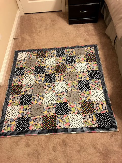 full view of the paw prints and tennis shoes quilt